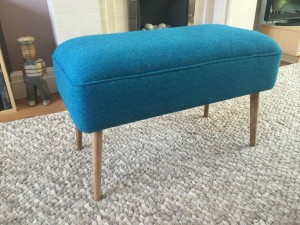 large mid century footstool in green herringbone tweed